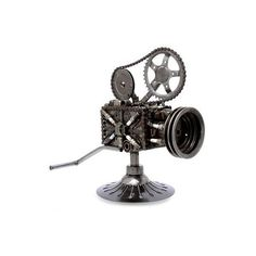 NOVICA Collectible Recycled Metal Movie Theater Sculpture (109.235 CLP) ❤ liked on Polyvore featuring home, home decor, clothing & accessories, metallic, sculpture, novica, novica home decor, bear home decor, movie home decor and metal sculpture