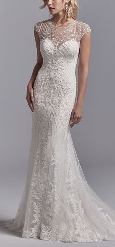 Sottero and Midgley - GRADY, This vintage-inspired wedding dress features a tulle overlay accented in geometric lace motifs with beading and pearls, creating an illusion jewel over sweetheart neckline, illusion cap-sleeves, and an illusion scoop back. Lined with Inessa Jersey for a luxe fit. Finished with pearl buttons and zipper closure.