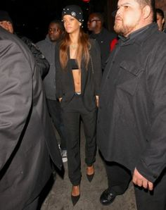 Rihanna wearing Manolo Blahnik BB Suede Leather Pump, Silver Spoon Attire Mesh Bow Beanie with Pearls and Chanel Bag.