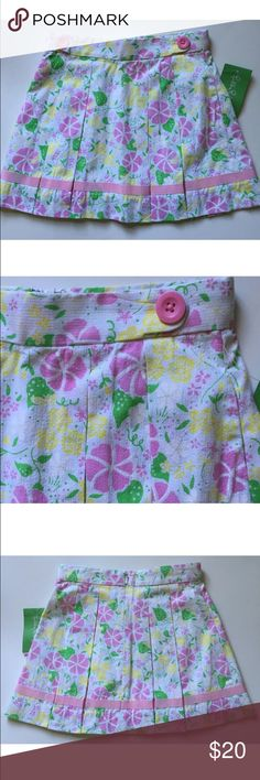 "Lilly Pulitzer Floral Skirt Lilly Pulitzer ""Emory""pleated floral seersucker skirt. The pattern is called ""Cupcake Party"" and the colors are white, green, pink, and yellow.  Does not have shorts underneath. 