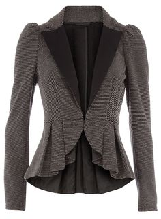 Grey peplum textured jacket with a black bow detail on the back.
