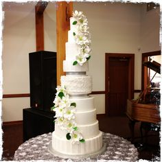 9 tier wedding cake with handmade gum paste flowers. By One Sweet Slice, South Jordan Utah By Janell Brown and Annelise Vesely