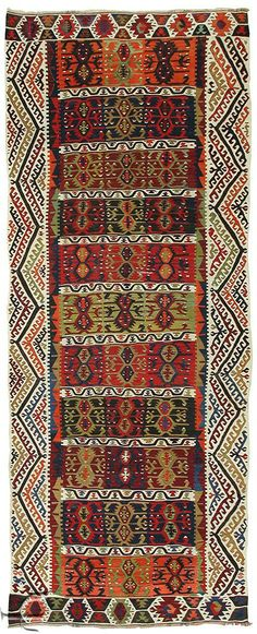 This is listed as a Turkish Kilim - no further info. Love those borders. Great colours.