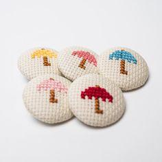 5 Buttons Fabric - Umbrellas Cross Stitch - 32mm. €7.00, via Etsy.