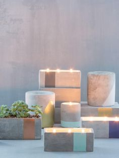Bring your urban garden indoors these city-inspired concrete vessels. This collection of on-trend concrete candles with geometric accents and are topped off with gold foil stamped dust covers. Soy wax. Three Cotton wicks. Hand poured in Nashville, TN.