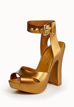 Inject your wardrobe with glamour this season with Vivienne Westwood's Elevated Sandal. Produced in gold plastic, the adjustable ankle strap is crafted with complementing gold elements to the eyelets and roller buckle, exquisitely finished with the Orb studded to the outside of the leg.
