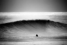 Finding peace in the wake of power. #blackandwhite #surfing