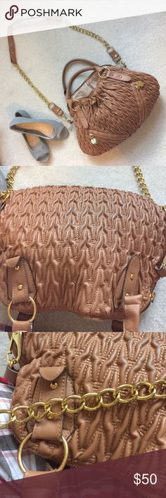 Tan Crossbody Used tan crossbody bag with gold hardware. Has jeans stain on back side not visible when worn. Gold hardware has minor wear. Zipper doesn't work. Please refer to pictures. Use offer button to negotiate on price. Not as brand listed. Coach Bags Crossbody Bags