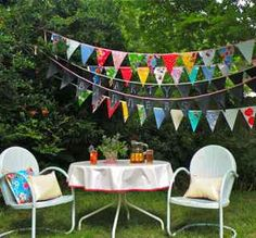 OILCLOTH!!! Party Banners from Modern June, $35 these would be cute in bugS playhouse!
