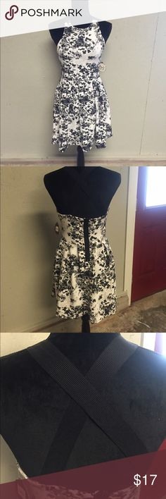 NEW Black Floral Stretch Crisscross Back Dress Brand NEW stretch material black, gray and white floral crisscross back dress. SO Dresses