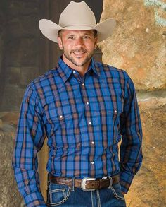 """Wrangler Men's Blue Plaid Wrinkle Resist Long Sleeve Western Shirt -  It features two snap pockets, front and back Western yokes and triple snap cuffs.