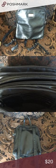 #Perlina Motto style black small leather backpack Sporty Perlina Motto style black all leather backpack with 3 compartments. Fell in love with the bag but it's always been too small for my needs. Preloved item in good condition. This is a vintage piece. Letting go for someone to enjoy. 10x8 Real Leather #Vintage. A unique piece Perlina Bags Backpacks