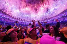 Fireworks illuminate the sky over the Maracana Stadium as athletes take photographs during the Opening Ceremony of the Rio 2016 Olympic Games.