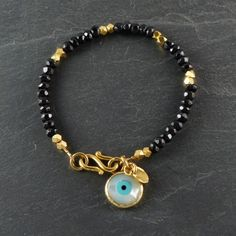 Gold vermeil and black agate bracelet with evil eye charm