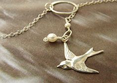 Dove Bird Necklace Silver Bird Lariat, Custom Bridesmaid gifts, pearl silver dove necklace bridal party gifts. $21.83, via Etsy.
