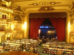 """Book Shop : -- - """"Ell Ateneo"""", in Buenos Aires, BRAZIL. - - - - The curtains, lighting and the stage cafe are a nod to the bookstores history. It was formerly a theatre."""