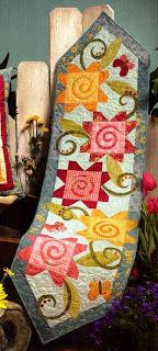 Garden Song by Nancy Halvorsen  great with raw edge machine applique on ivory pieced background in wood flooring colors