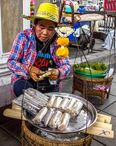 Woman selling bamboo sticky rice in Bangkok, Thailand