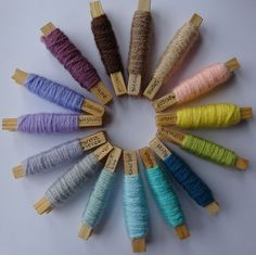 Color-planning with yarn pegs.