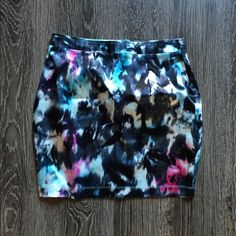 Multicolor tie dye miniskirt Brand new with tags. Is tagged as both a US size 6 and a medium. Sits higher on the waist. 16.3 inches long. 100% viscose. The brand is called this is a love song as is sold at retailers such as pacsun, urban outfitters, and dolls kill. Sold out online! Make an offer. Urban Outfitters Skirts Mini