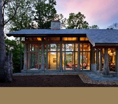 Timberframe with very clever use of rounded tree trunks. Norris Architecture.