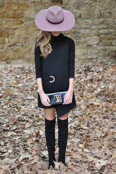 Louis Vuitton Clutch, high boots and black dress