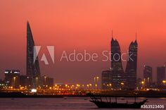 A beautiful view of Bahrain skyline during evening hours at sunset #AD , #Bahrain, #view, #beautiful, #skyline, #sunset Evening Hours, Empire State Building, Travel Guides, Digital Illustration, Beautiful Places, Skyline, Culture, Stock Photos, Explore