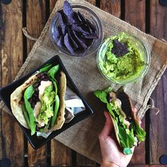 Homemade 100% whole wheat tortillas filled with lettuce, black beans, chipotle yogurt sauce, guacamole and salsa (on the bottom, leftover from last week) plus blue corn chips and extra guacamole on the side // cait's plate