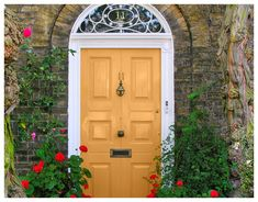 A front door is refreshed with an earthy yellow paint. (Part of ...