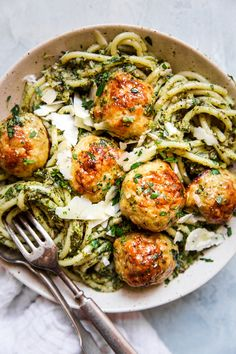 Baked Chicken Meatballs with Broccoli Pesto Pasta by The Modern Proper With just five ingredients, these parmesan-loaded baked chicken meatballs are good any way you serve them. But, paired with a hearty roasted broccoli pesto and… Ground Chicken Meatballs, Chicken Parmesan Meatballs, Chicken Meatball Recipes, Chicken Recipes For Kids, Pasta With Meatballs, Chicken Meatballs Recipe Easy, Recipes For Four, How To Bake Chicken, Healthy Ground Chicken Recipes