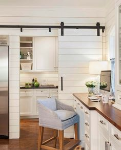 Check out post for a beautiful collection of barn doors which can be used to cover a TV, window, and more!