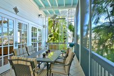 Dining porch overlooking the gardens at Ocean View Luxury Villa Key West Rentals, Victorian Cottage, Cottage Style Homes, Open Water, Gated Community, Classic House, Luxury Villa, Old Town, Porches