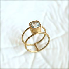 Double Wheel Gold Ring With Aquamarine Stone. From illuminancejewelry on Etsy.