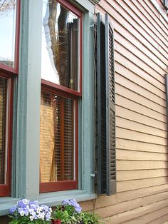 Almost 99 percent of window shutters on homes are wrong resulting in very bad curb appeal. See if your shutters are bad and learn what to do right to make your home look its best. Outside Window Shutters, Window Shutters Exterior, Outdoor Shutters, Louvered Shutters, Exterior Paint, Pallet Shutters, Interior Wood Shutters, House Window Design, Shutter Designs
