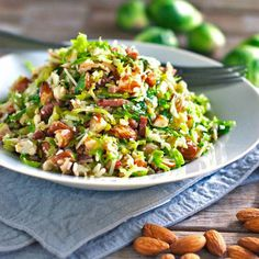 This bacon and brussel sprout salad is so good! Thinly sliced brussel sprouts, crumbled bacon, Parmesan, almonds, and shallot citrus dressing. | pinchofyum.com