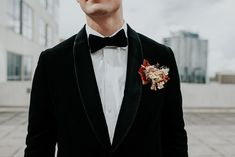 Groom in black velvet vest with boho boutonniere. This urban inspired wedding inspiration shoot at The Balcony Orlando was all about the spring influences and incredible fashion. Click pin to see more! Orange Blossom Bride | Orlando Wedding Blog #orlandoweddings #thebalconyorlando #modernwedding #weddingstyle #weddinginspiration #weddinginspo #modernboho Groom And Groomsmen Looks, Groom Looks, Wedding Blog, Wedding Styles, Black Velvet Jacket, Spring Wedding Inspiration, Looking Dapper, Orlando Wedding, Groom Attire