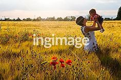 Mum and baby in a poppy field