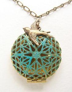 Blue filigree locket necklace, Turquoise filigree bird locket necklace - bird nest locket necklace. $19.50, via Etsy.