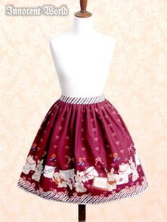 Brand:  Innocent World Item Type:  Skirt Price:  ¥16,590 Year:  2012 Colors:  Wine/Bordeaux Features:  Lining, Partial shirring, Detachable waist ties Waist:  60cm~74cm Length:  55cm (including 1cm of lace) Owner notes:  Belt width: 3cm