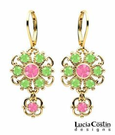 Classy Flower Dangle Earrings Designed by Lucia Costin Adorned with Twisted Lines, Light Green and Rose Pink Swarovski Crystals; 14K Yellow Gold Plated over .925 Sterling Silver; Handmade in USA Lucia Costin. $54.00. Embellished with peridot and rose Swarovski crystals. Unique jewelry handmade in USA. Update your everyday style with inspiration when wearing this piece of jewelry. Lucia Costin floral Dangle earrings. Dangle ornaments accented with floral design