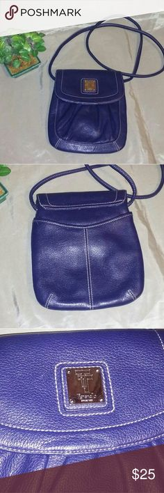 Tignanello over-the-shoulder leather purse Dark blue leather never been used in perfect condition. Pocket on the outside in the back and park it on the outside in the front. There are many compartments on the inside and zipper pocket and open Pocket. I absolutely adore this shoulder purse. I have 2 of these and the other is black. 8x1x9 Tignanello Bags Crossbody Bags