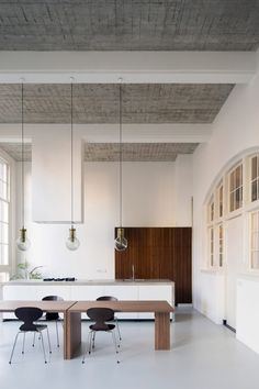 Dutch practice Eklund Terbeek combine contemporary and original features in this loft apartment, which sits inside an old schoolhouse in Rotterdam.