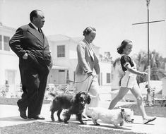 Alfred Hitchcock, his wife Alma Reville and daughter Patricia go for a walk in Bel Air, California