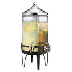 Side-by-side glass beverage dispenser with chrome spouts on a black stand.  Product: Drink dispenserConstruction Material: Chrome and glassColor: Clear and blackFeatures:  Eliminates sticky handles and spillsEach side has a 1.25 gallon capacity  Note: For use with cold beverages onlyCleaning and Care: Handwash
