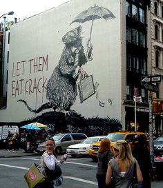 banksy's message towards wall street. very powerful symbolic statement in street art.