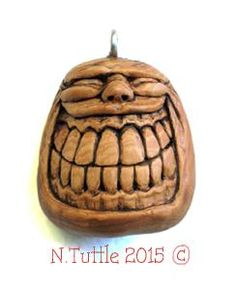 """Smile High""     1½ inches tall and 1¼ inches across his width.  Signed and dated:   N. Tuttle 3/11/15"