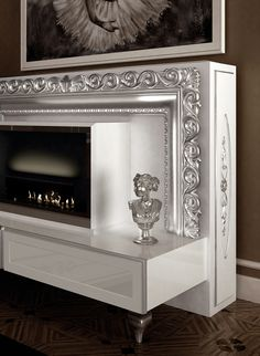 #vismaradesign mothorized tv stand lift&fire 182 #baroque silver foil detail. The remote control commands the ascent and the descent of television, giving an impulse to the electronic mechanism inside the console. #luxury #madeinitaly