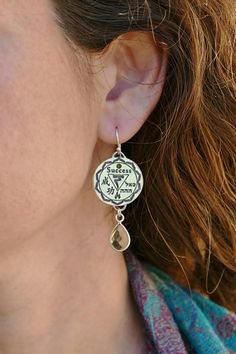 Success Amulet Earrings, Spiritual healing jewelry, A gift with meaning, Silver charm earring, Yoga jewelry Gift, 92.5 sterling silver Earrings with Citrine Gemstone. Chakras. Kabbalah. Chinese Kanji Charm. Inspiring Words & Symbols. The Energy Gates combine ancient symbols from different cultures and religions. Recognizing and Respecting the truth and the strong message within them all.  SUCCESS This Amulet bears ancient symbols that will fortify willpower. Empower the will for progress ...