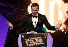Michael Fassbender presents the BFI Fellowship Award at the BFI London Film Festival Awards during the 60th BFI London Film Festival at Banqueting House on October 15, 2016 in London, England.