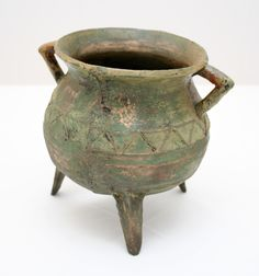 Medieval Bronze tripod pot. Shape and glaze inspiration—I love those pointy arms.    (via Bronze tripod pot)